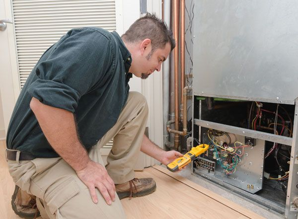 Service man checking heater